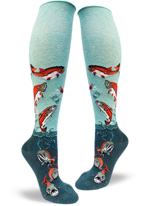 Knee-high salmon socks for women with fish swimming on a blue background with an extra-stretchy cuff