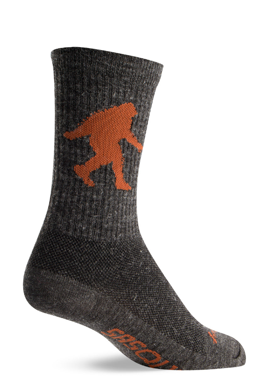"Wool Sasquatch socks for men and women with Bigfoot in the classic pose and the word ""SASQUATCH"" on the foot"