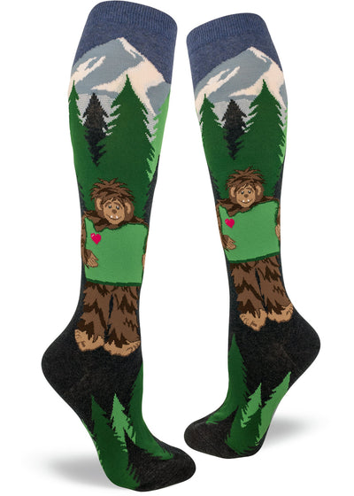 Knee-high Sasquatch Loves Oregon socks for women with bigfoot holding Oregon with trees & mountains in the background