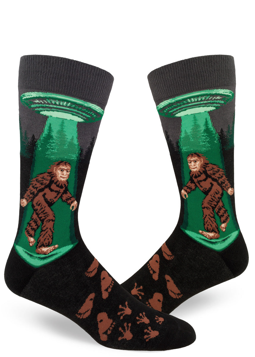 Sasquatch socks for men with Bigfoot and a flying saucer in the forest