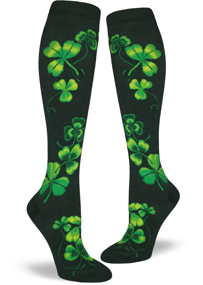 Deep green knee socks for women with shamrocks in a bright green color.