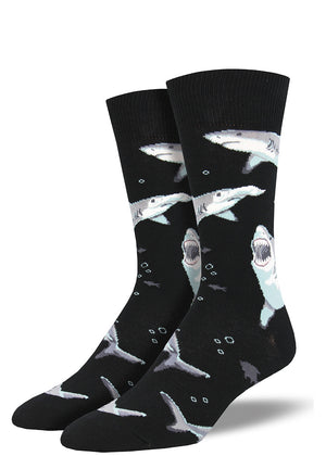 Scary sharks swim against a dark black sea on these men's shark socks.