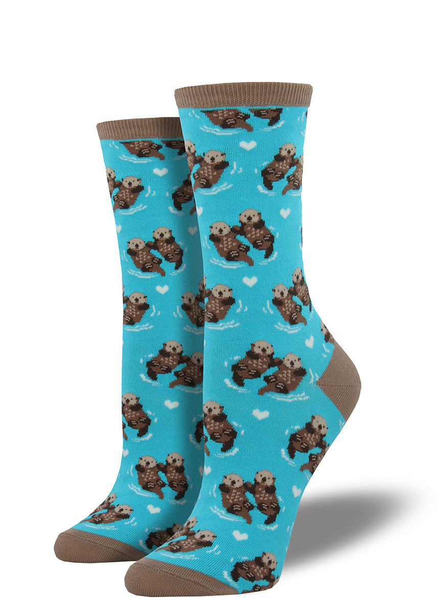 Adorable otter couples hold hands while they float on these crew socks for women.