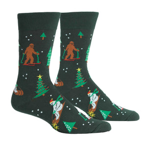 Sasquatch and Yetis ski on these funny Christmas/winter socks for men.