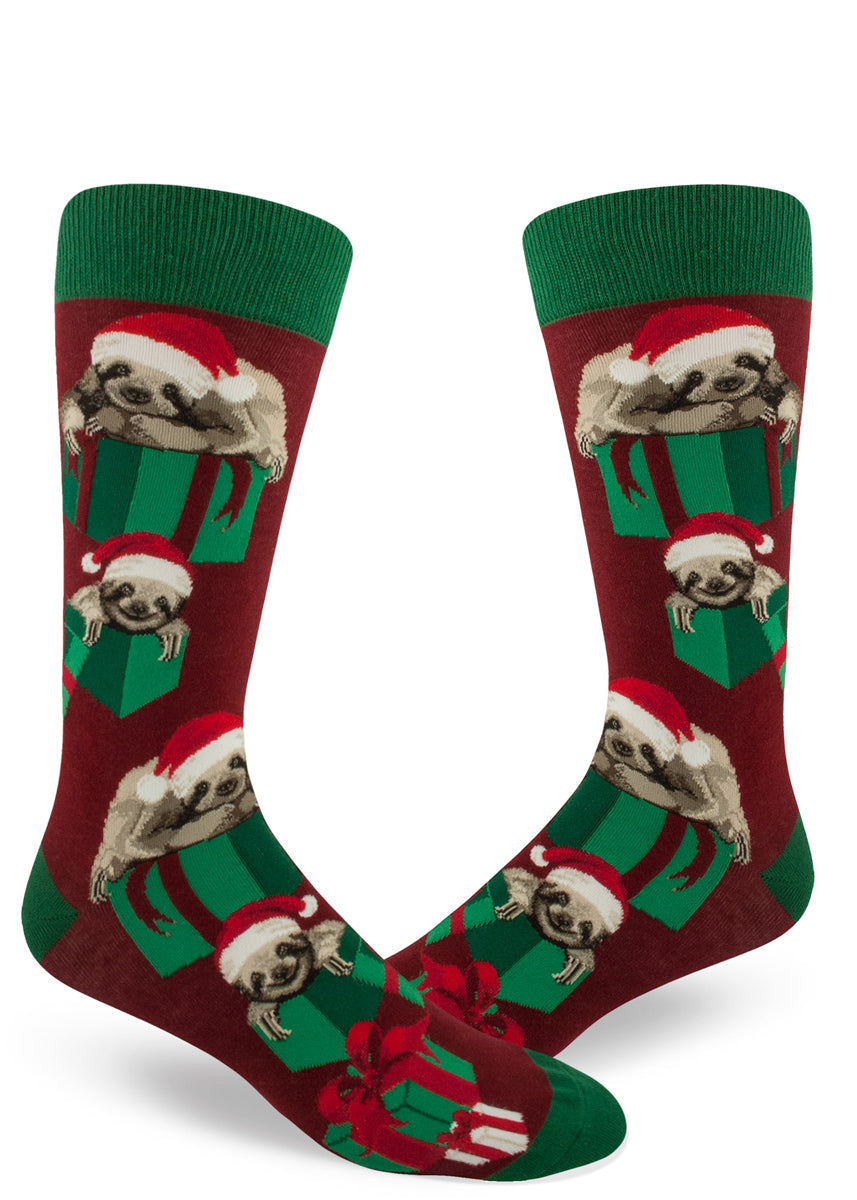 Christmas sloth socks for men with sloths in Santa hats and presents on a red background
