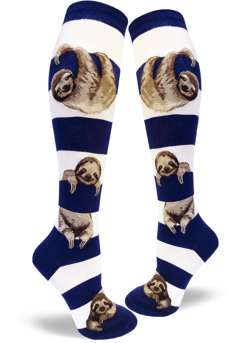 Cute knee-high sloth socks for women with sloths hanging between navy and white stripes