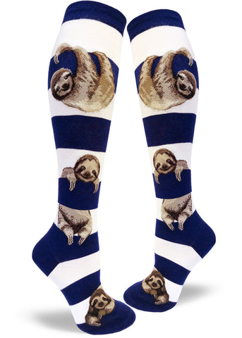 Knee-high sloth socks for women with sloths hanging between navy and white stripes
