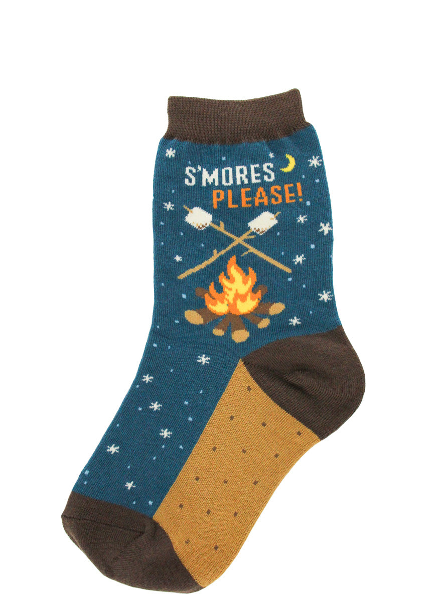"Cute camping socks for kids feature marshmallows on sticks over a campfire with the words, ""S'mores Please!"""