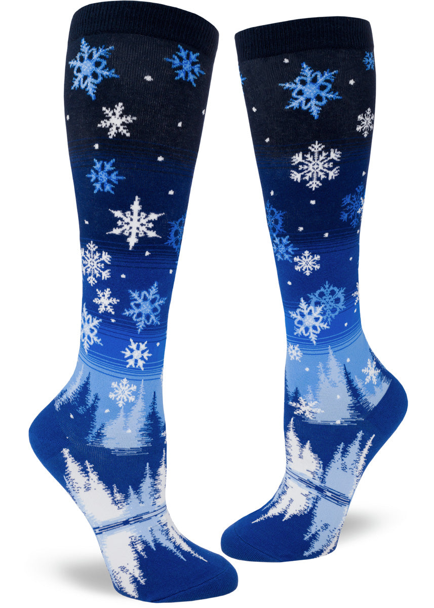 Snowflake knee-high socks for women with night sky full of snow and snowy trees