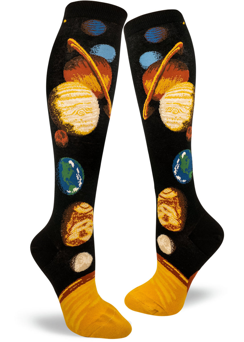 Solar system socks for women with the planets, moon & sun going along the knee-high with a black background