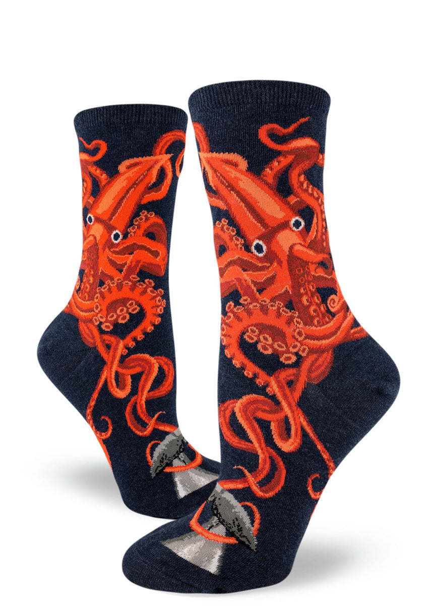Squid socks for women with giant squid in bright orange and red with a dark navy blue background