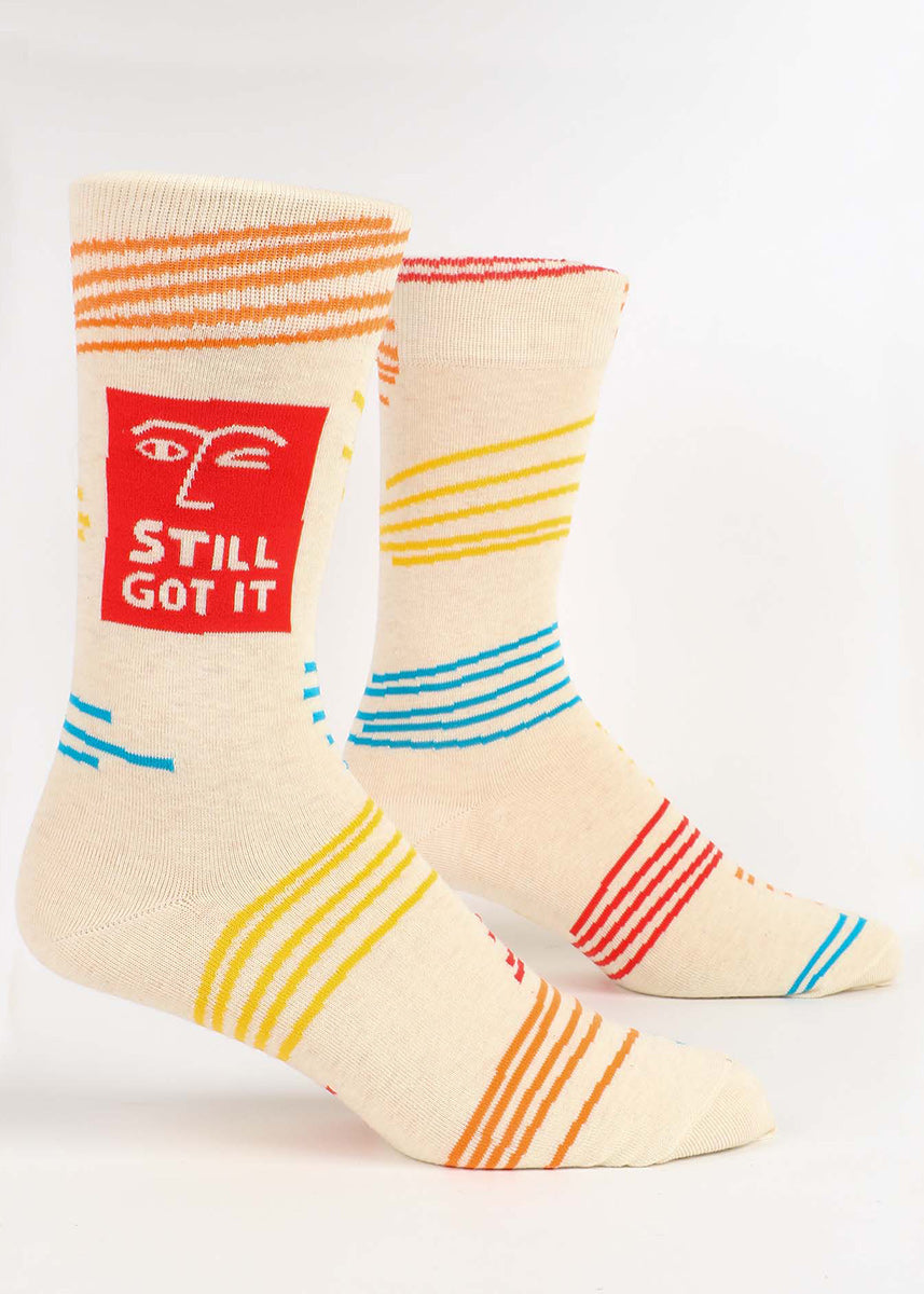 "Funny socks for men feature an abstract winking face with the words, ""Still got it."""