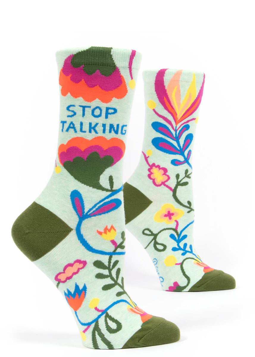 "Crew socks for women feature colorful abstract floral designs with the words, ""Stop Talking!"""
