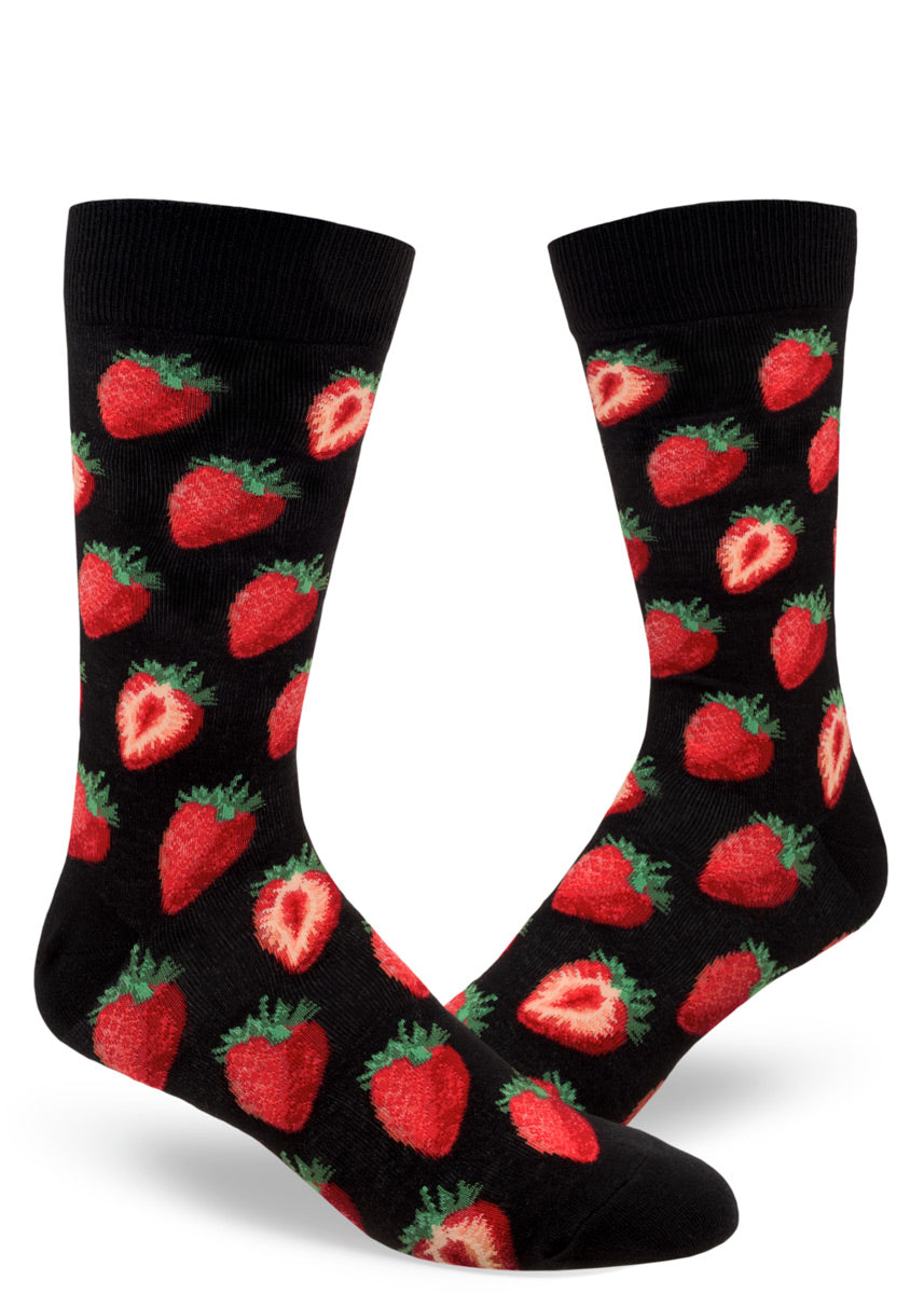 Black crew socks for men covered in whole and halved strawberries.
