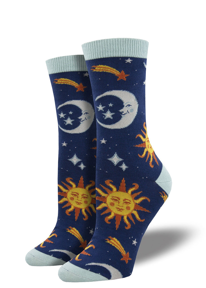 Bamboo crew socks for women feature suns and moons with faces surrounded by stars in the night sky.