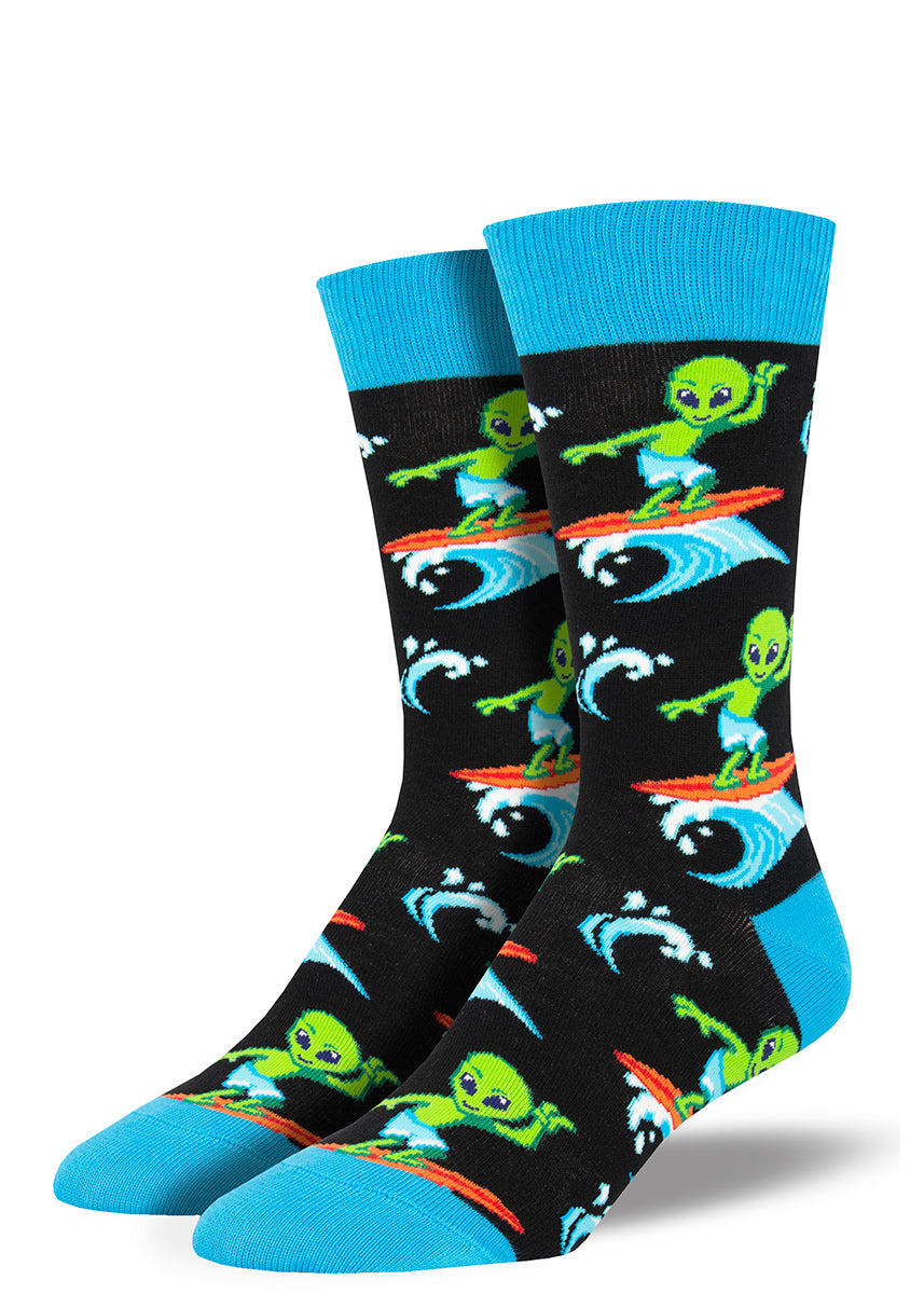 Surfing alien socks for men with green aliens riding on surf boards and flashing peace signs