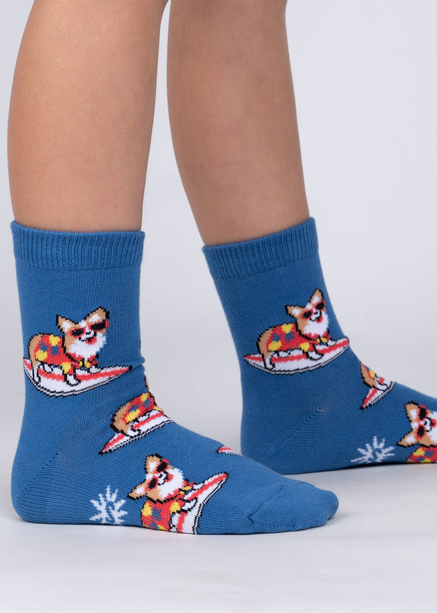 Cute dog socks for kids feature adorable sunglasses-wearing corgis on surfboards!