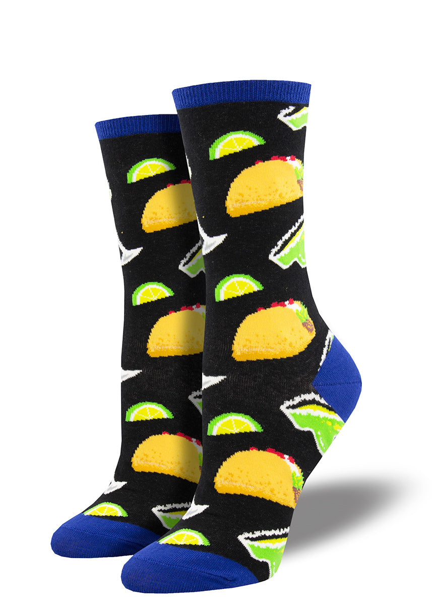 Crew socks for women feature tacos, margaritas, and extra limes on a black background.