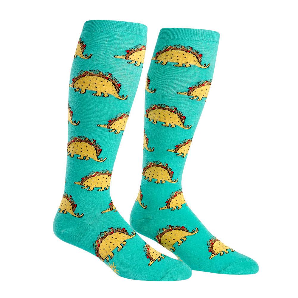 Tasty taco dinosaurs decorate these supremely stretchy socks.