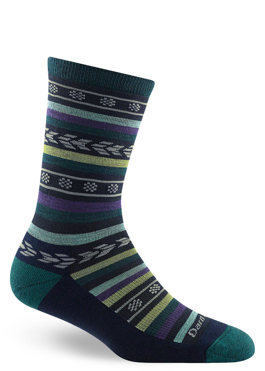 Wool hiking socks for women feature a cushioned footbed and a funky striped design in dark teal and purple.