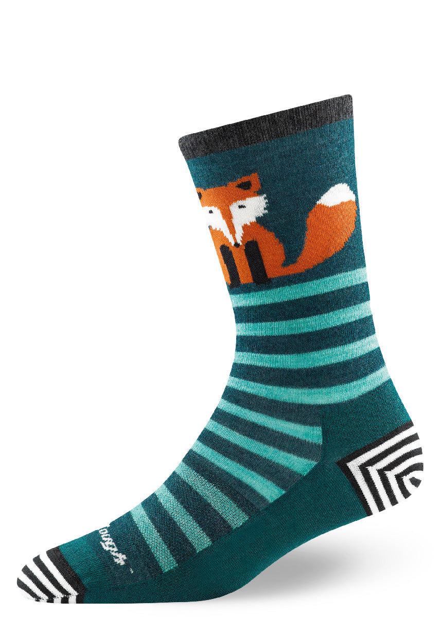 Wool socks for women show an orange fox on a striped teal background.