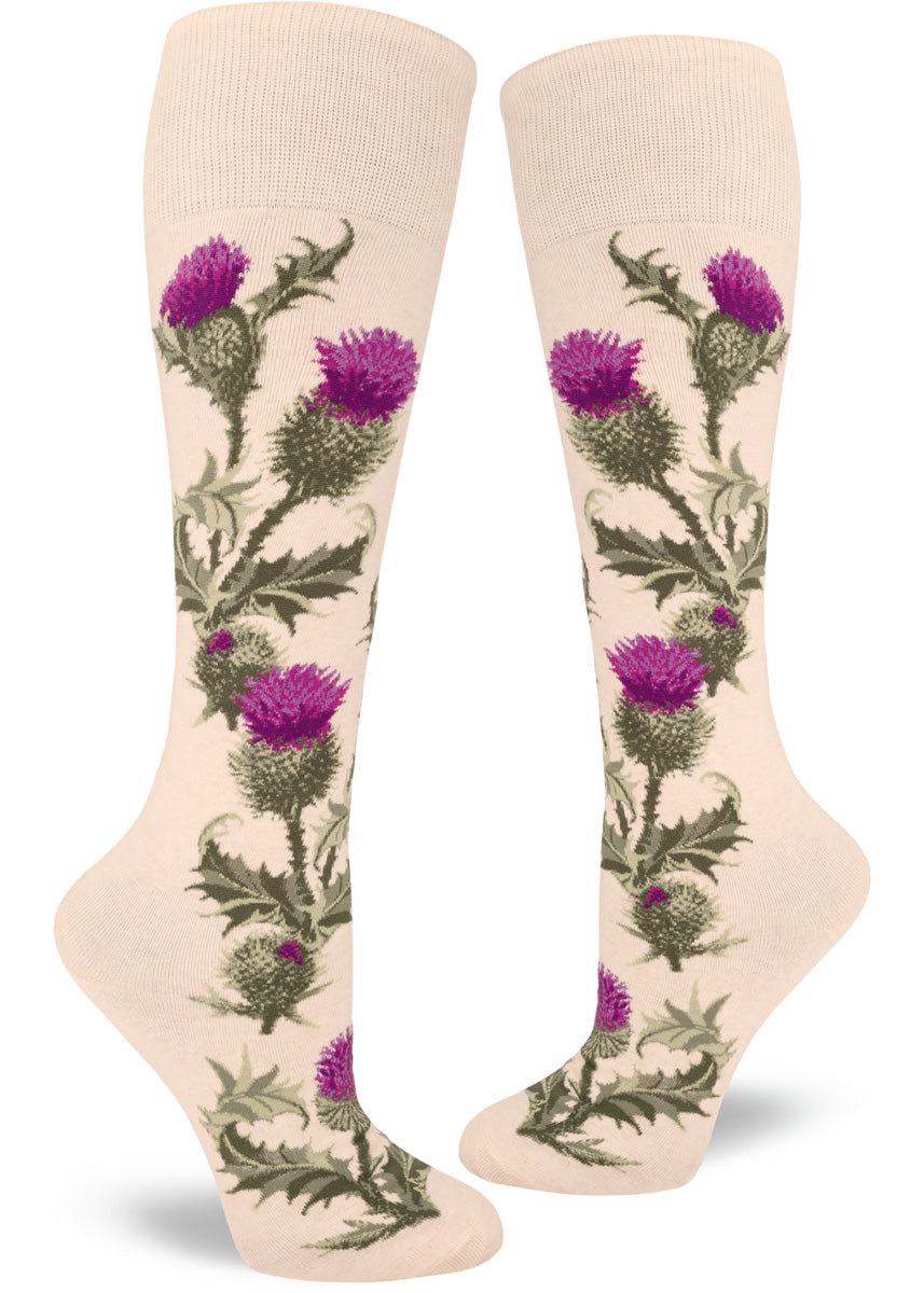Knee-high thistle socks for women with thistle flowers and leaves on a cream background