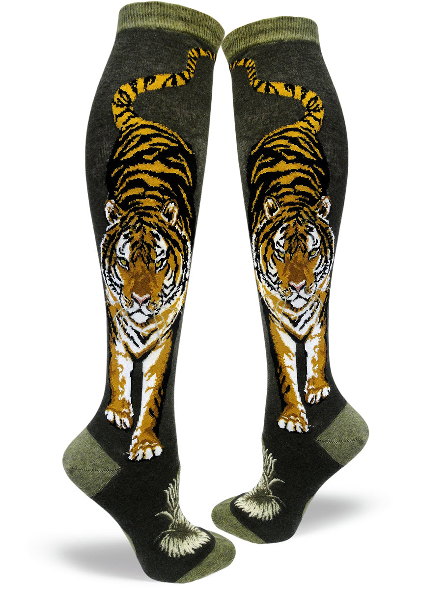 Tiger knee-high socks for women with tigers on a green background
