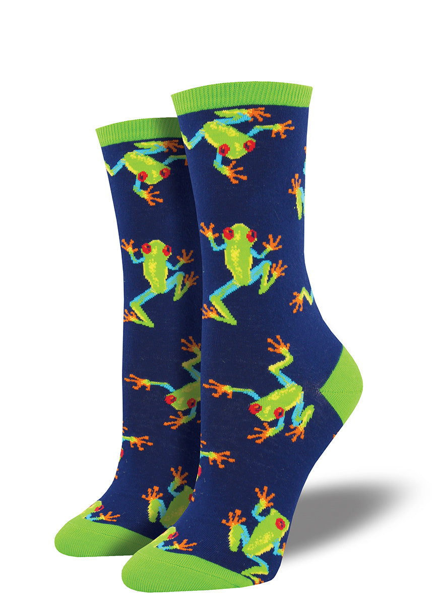 Cute frog socks for women feature tropical tree frogs with green bodies and red eyes on a navy blue background.