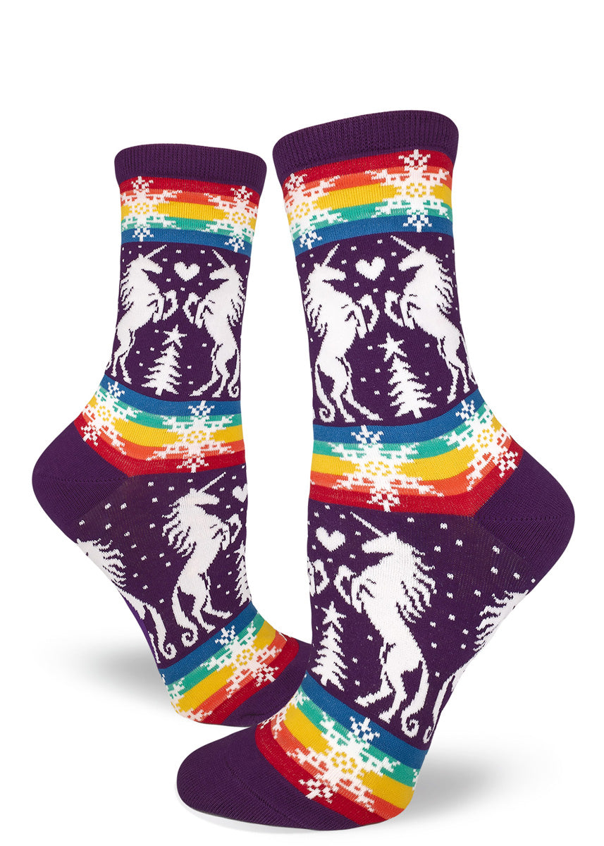 Funny gay Christmas socks for women with unicorns and rainbows on a purple background.