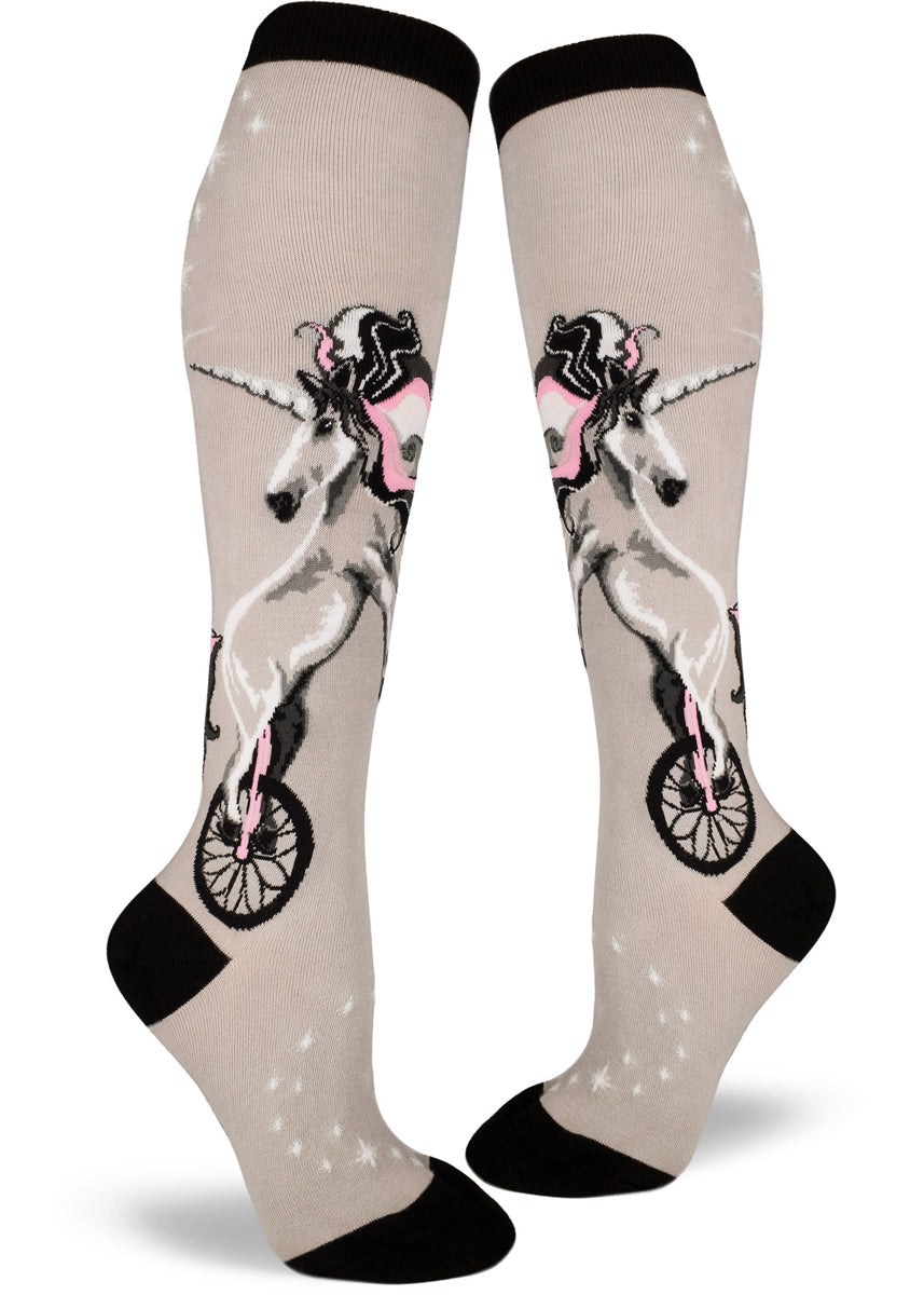 Unicorn knee-high socks for women with unicorns riding unicycles with pink and silver shimmer accents on light gray socks