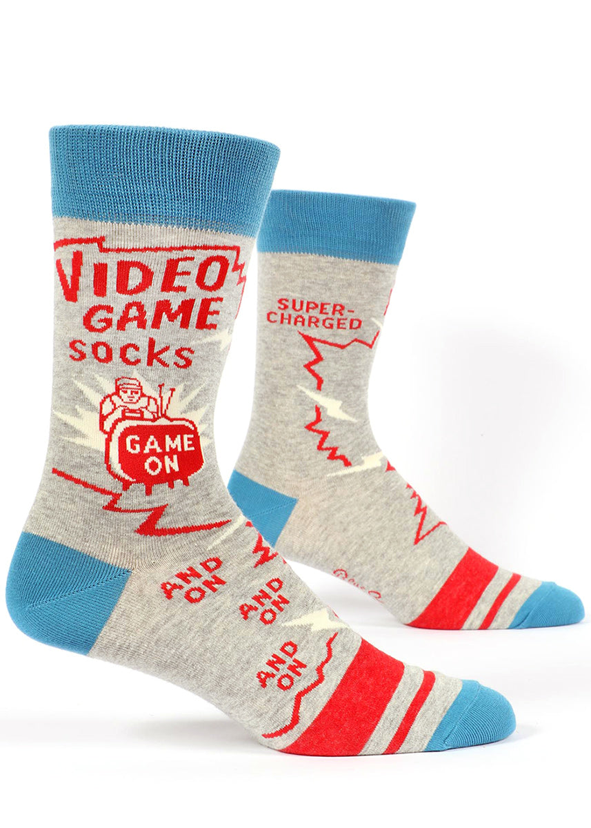 "Video game socks for men that say ""Video Game Socks"" and ""Game on"" with a gamer in front of a television"