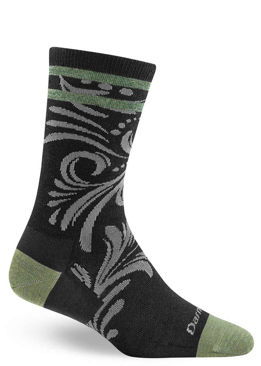 Pretty wool socks for women with twisted vines on a green and black background