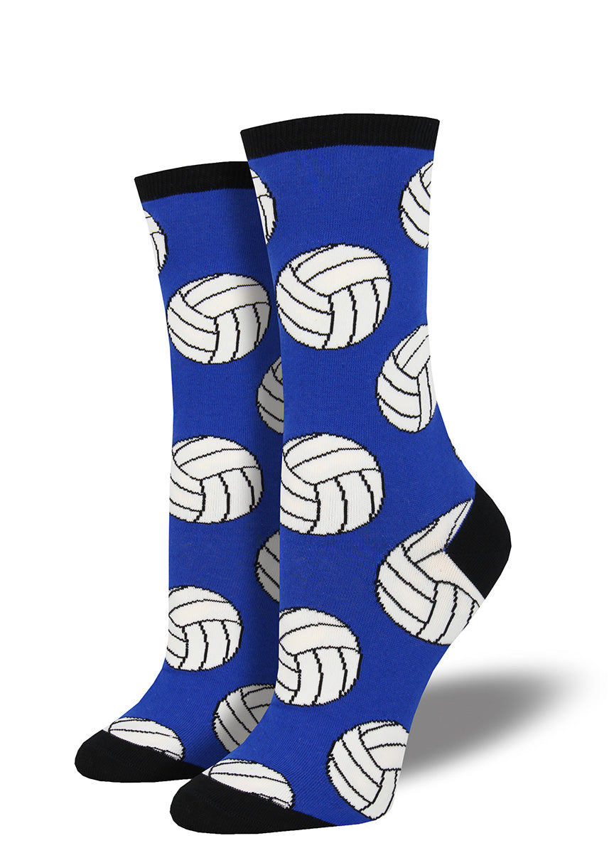 Volleyball socks for women with volleyballs on a blue background