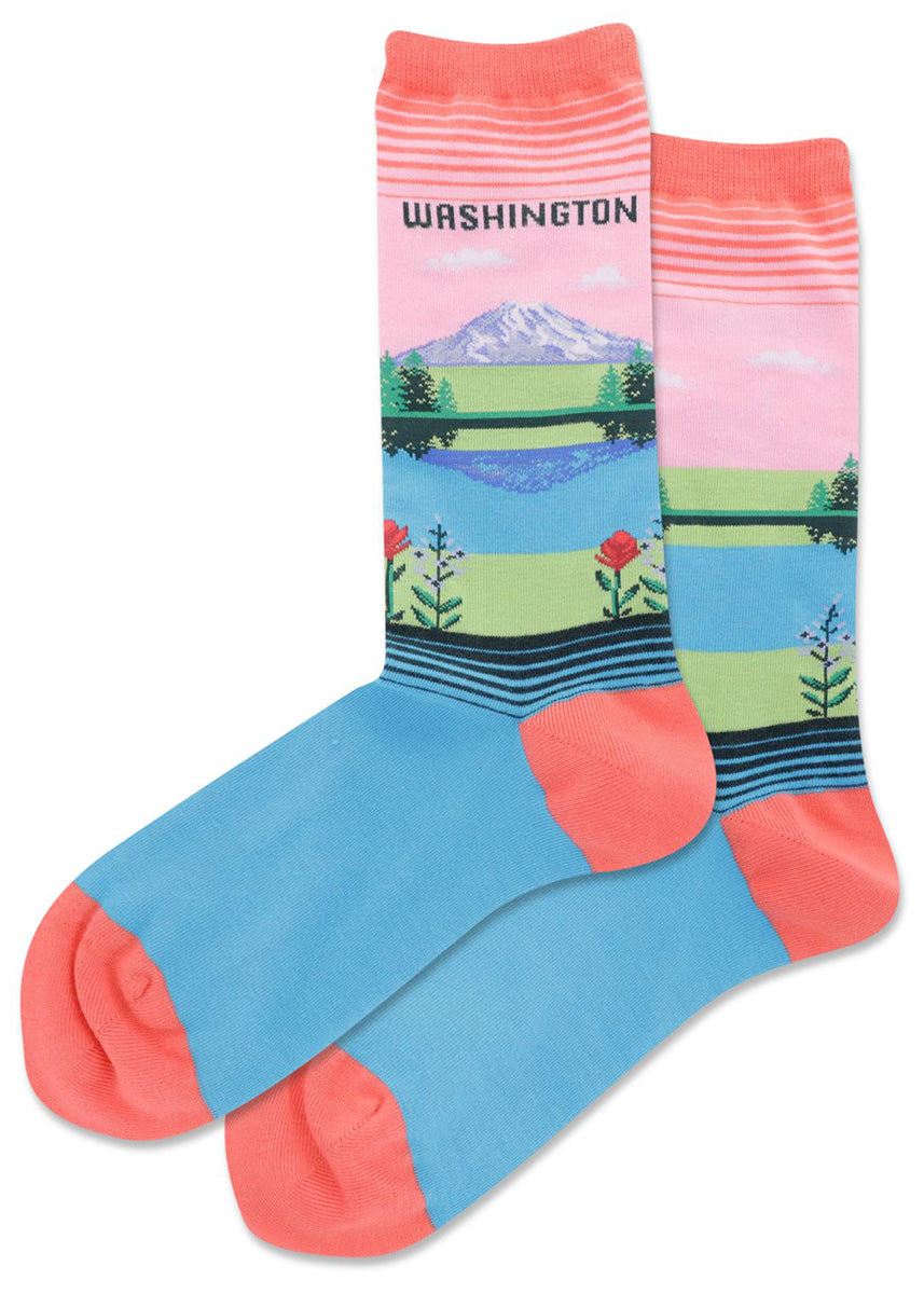 Washington state crew socks feature gorgeous Mount Rainier in front of a pink sky and reflected in water with evergreen trees and the state flowers all around!