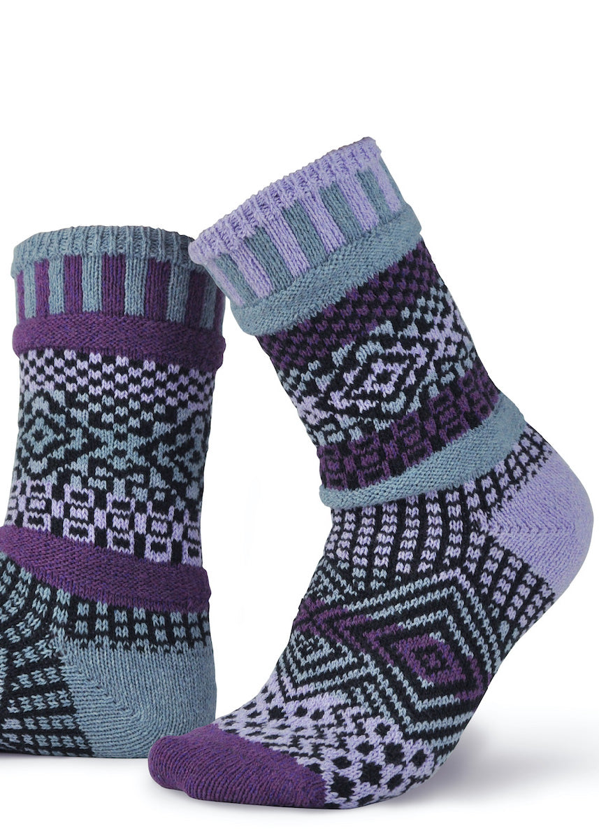 Funky patterned socks are intentionally mismatched and feature shades of dark purple, light purple, cool gray, and black!