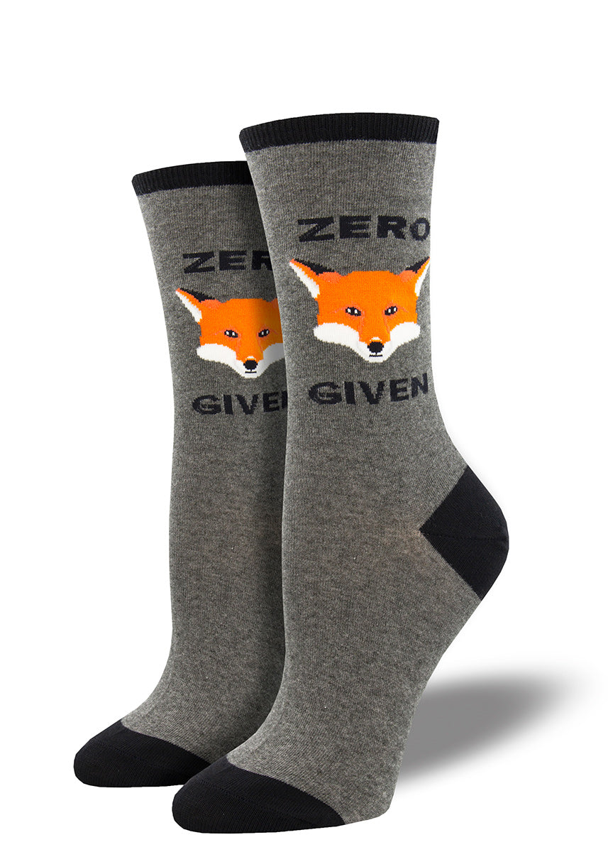 "Crew socks for women use a fox face to spell out ""Zero Fox Given"" on a gray background."