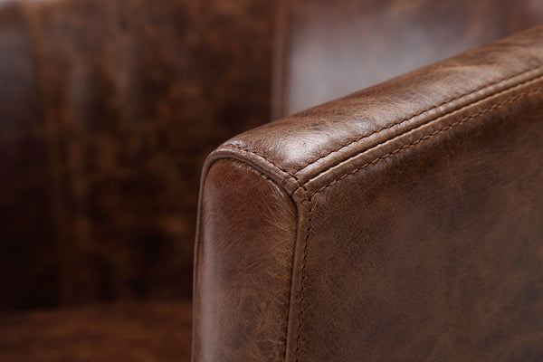 Armrest of the Alcove leather chair