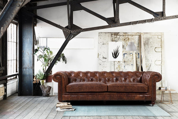 Kensington Chesterfield Leather Sofa by Rose & Moore in a Loft