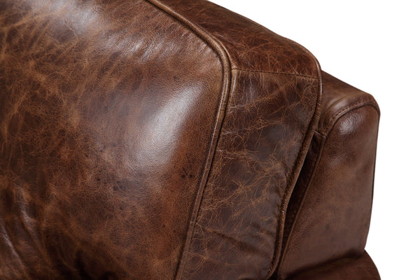 Cushion in distressed brown leather color