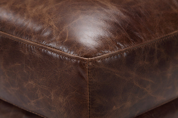 Distressed brown leather cushion