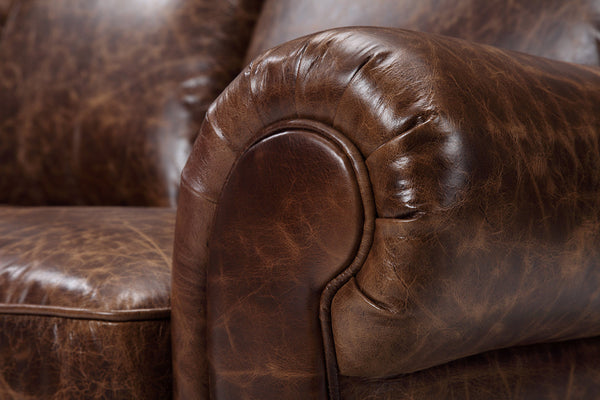 Traditional leather couch armrest