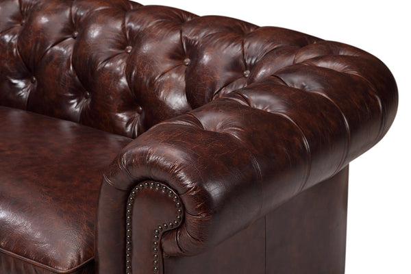 Chesterfield couch in brown burgundy color