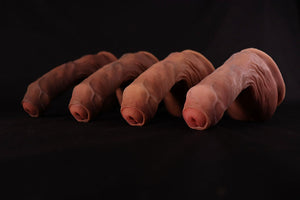 Four Jimmy STP uncut in a row, lightest to darkest skin tone.