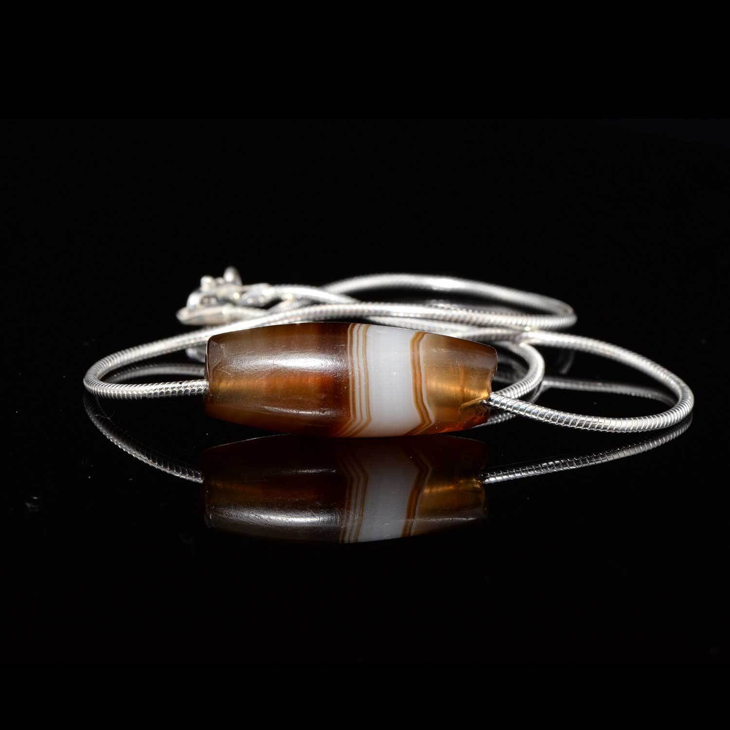 A Near Eastern Banded Agate set as a pendant, ca. 1st millennium BCE - Sands of Time Ancient Art