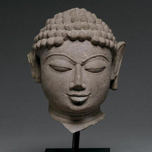* A mottled red sandstone head of a Jina, India, 11th/12th century CE