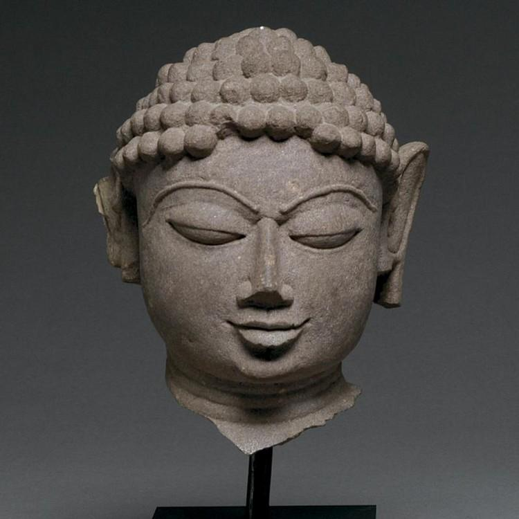 * A mottled red sandstone head of a Jina, India, 11th/12th century CE - Sands of Time Ancient Art
