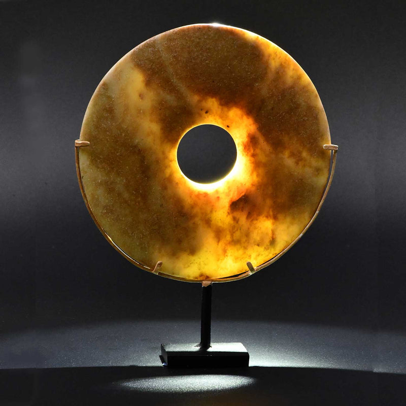 A Chinese Mottled Nephrite Jade Bi Disc, Late Neolithic Period, ca. 3000 - 2000 BCE