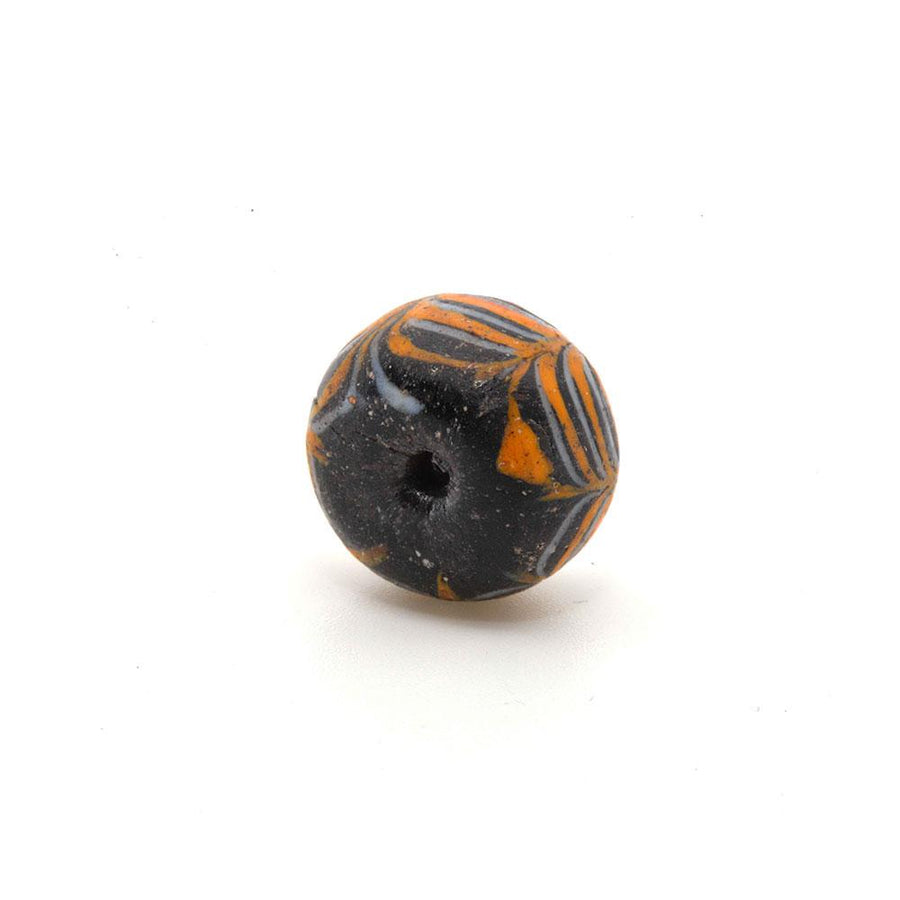 * An Islamic Glass Bead, ca. 9th century CE - Sands of Time Ancient Art