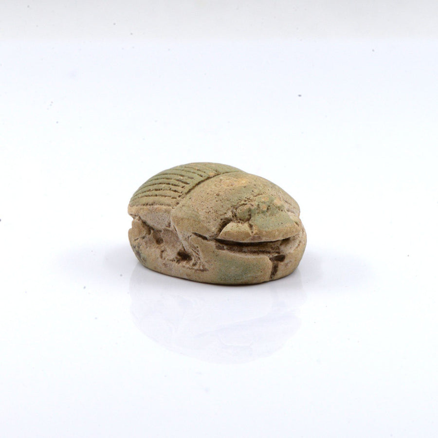 A large Egyptian Pale Green Glazed Scarab, Late Period, Dynasty 26, ca. 664 - 525 BC