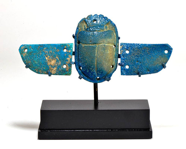 An Egyptian Faience Winged Scarab, 21st Dynasty, 1069 - 945 BC
